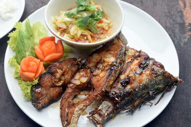 Fried fish with green mango salad